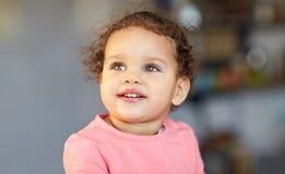 Beautiful little mulatto baby girl face Stock Photo