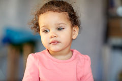 Beautiful little mulatto baby girl face. Childhood and people concept - beautiful little mulatto baby girl face Royalty Free Stock Images
