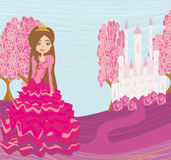 Beautiful little princess in front of her castle Royalty Free Stock Photography