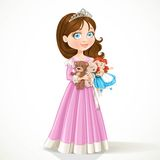 Beautiful little princess in tiara holding soft toys Royalty Free Stock Images