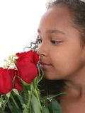 Beautiful Little Princess With Tiara Smelling Roses Over White stock photography