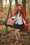Beautiful little red riding hood smiles Royalty Free Stock Images
