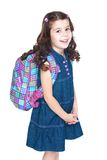 Beautiful little schoolgirl with a knapsack on his Royalty Free Stock Images
