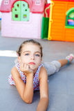 Beautiful little serious girl lying on floor Royalty Free Stock Photos