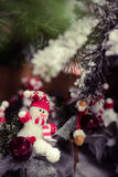 Beautiful little snowman ornament with red apples Stock Photography