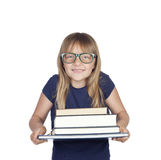 Beautiful little student with glasses and many books Royalty Free Stock Photo