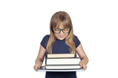Beautiful little student with glasses and many books Stock Images