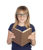Beautiful little student with glasses reading a book Royalty Free Stock Photo
