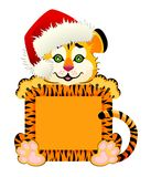 beautiful little tiger in a red cap Royalty Free Stock Photo