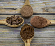 Beautiful little wooden spoon with coffee on  background Stock Images