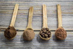 Beautiful little wooden spoon with coffee on  background Royalty Free Stock Photography