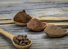 Beautiful little wooden spoon with coffee on  background Royalty Free Stock Photos