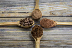 Beautiful little wooden spoon with coffee on  background Royalty Free Stock Photo