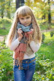 Beautiful little young baby stands in a scarf. Lovely child Stock Images