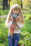Beautiful little young baby stands in a scarf. Lovely child Stock Image