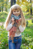 Beautiful little young baby stands in a scarf. Lovely child Royalty Free Stock Photos