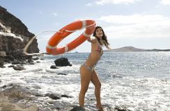 Beautiful liveguard with an orange lifebuoy Royalty Free Stock Photo