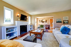 Beautiful living room interior with cozy fireplace Stock Photo