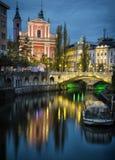 Beautiful Ljubljana, Slovenia. Ljubljana at night, with the Triple Bridge and Franciscan Church, Slovenia Royalty Free Stock Photo