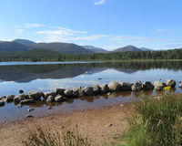 Beautiful Loch Morlich, Scotland. Early morning at the picturesque Loch Morlich in Glenmore, near Aviemore in the Scottish Highlands Stock Photo