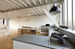 Beautiful loft. Interior, beautiful kitchen of an old loft Royalty Free Stock Photography