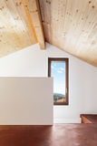 Beautiful loft, interiors. Comfortable empty loft, interior, room with window Stock Photography