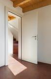 Beautiful loft, interiors. Comfortable empty loft, interior, room with door open Stock Photos