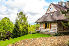 Beautiful log cabin in forest Stock Photos
