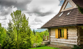 Beautiful log cabin in forest Royalty Free Stock Image