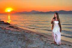 Beautiful lonely girl. On the seashore Stock Photo
