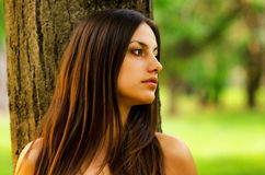 Beautiful lonely girl in the park Royalty Free Stock Photography