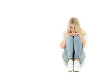 Beautiful lonely girl sitting on the floor Royalty Free Stock Photo