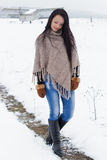 Beautiful lonely happy girl with long black hair walks in the clear frosty winter day Royalty Free Stock Photos