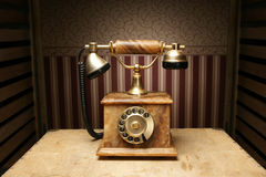 A beautiful lonely old brown telephone on a desk Royalty Free Stock Image
