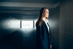 Beautiful lonely woman in a subway tunnel royalty free stock photos