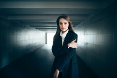 Beautiful lonely woman in a subway tunnel royalty free stock photography
