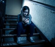 Beautiful lonely young girl depressed and worried suffering from bullying and harassment at school royalty free stock photo