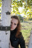Beautiful lonely young girl near a birch. The beautiful lonely young girl near a birch royalty free stock photography