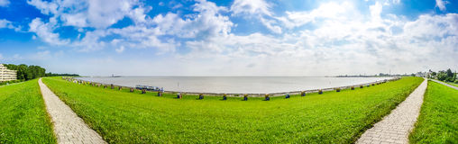 Beautiful long beach with typical northsea beachchairs in Cuxhaven, Germany. Panoramic view of beautiful long beach with typical north sea beach chairs in Stock Images