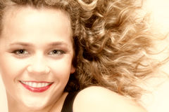 Beautiful long blond curly hair of young woman Royalty Free Stock Photos