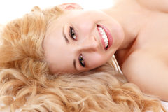 Beautiful long blond healt curly hair of young attractive woman Royalty Free Stock Photography