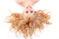 Beautiful long blond healt curly hair of young attractive woman Stock Image