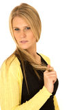 Beautiful long blonde haired woman looking over shoulder with ha Royalty Free Stock Photography