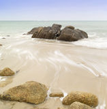 Beautiful long exposure image of golden sand beach Royalty Free Stock Images