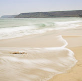 Beautiful long exposure image of golden sand beach Stock Images