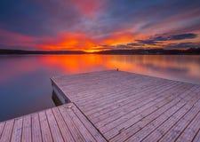 Beautiful long exposure lake at sunset landscape. Stock Photo