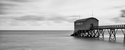 Beautiful long exposure landscape image of jetty at sea Royalty Free Stock Photos