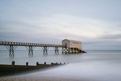Beautiful long exposure landscape image of jetty at sea Stock Photos