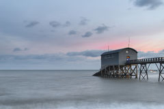 Beautiful long exposure landscape image of jetty at sea Stock Photography