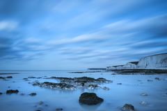 Stunning long exposure landscape image of low tide beach with ro Stock Images